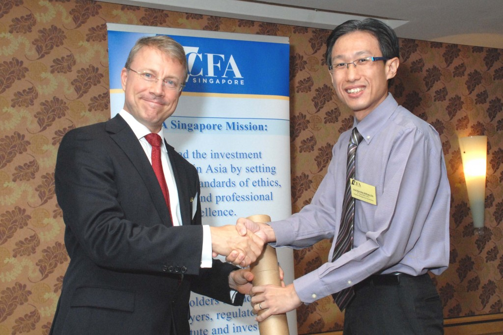 Charter Recognition Ceremony - 8th December 2011. Wilfred Ling (right) receiving the CFA charter from Mr. Daniel Schaefer, President of CFA Singapore.